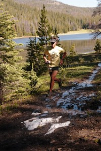 Runner passing by Cottonwood Lake on the Continental Divide Trail (50K)